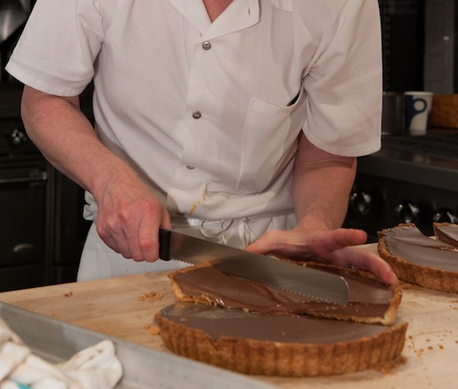 Slicing tarts in the Beard House kitchen